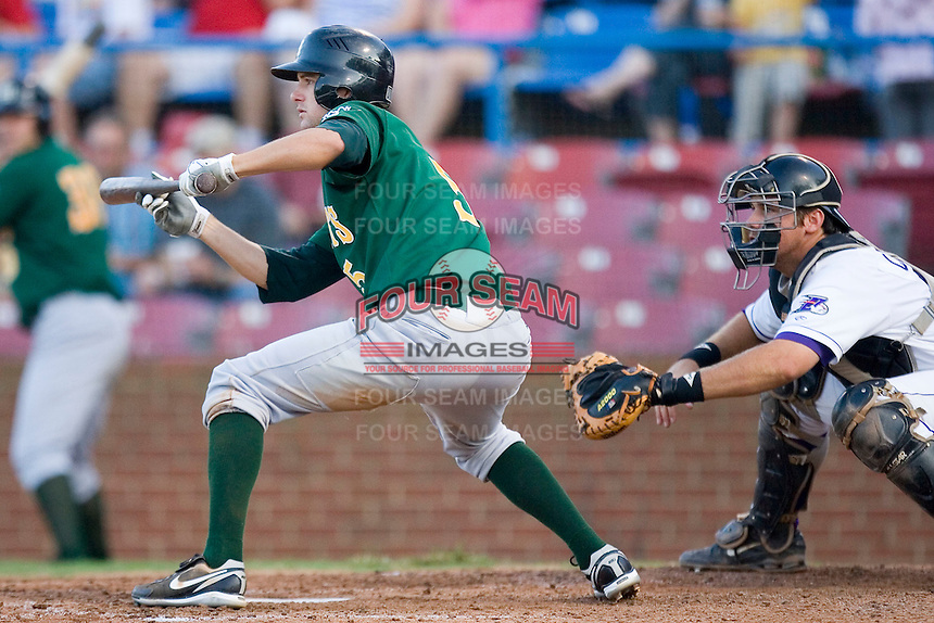 Jordy Mercer #5 of the Lynchburg Hillcats squares to bunt at Wake Forest Baseball Stadium August 29, 2009 in Winston-Salem, North Carolina. (Photo by Brian Westerholt / Four Seam Images)