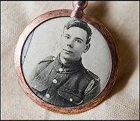 BNPS.co.uk (01202 558833)<br /> Pic: PhilYeomans/BNPS<br /> <br /> Locket picture of Pte Ambrose.<br /> <br /> Discovered in a loft - Poingnant reminder of families tragic loss during the Great War.<br /> <br /> A moving time capsule containing the last belongings of a dead soldier his family couldn't bring themselves to look at has been found in an attic after 98 years.<br /> <br /> The possessions of Private Edward Ambrose were sent home from the Western Front to his devastated parents after he was killed at the Somme.<br /> <br /> Too painful to look at, the poignant items were shut into a leather case and put into storage where they remained for almost a century.<br /> <br /> The case has now been opened by Pvt Ambrose's 82-year-old nephew who recovered it after reading about an appeal for untold stories for a local First World War exhibition.<br /> <br /> The effects include black and white photos of his loved ones, letters from his parents, his half-smoked pipe and a cigarette case with 10 roll-ups.