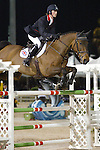 Darragh Kerins and Night Train compete for Ireland in the $75,000 FEI Nations Cup, an Olympics-style show jumping event, on Friday night, Feb. 28, 2009, during the Winter Equestrian festival in Wellington, Fla. Canada won the eight-nation, two-round competition before the first sellout (8,000) at the recently-renovated Palm Beach International Equestrian Center. Canada edged Ireland and Great Britain (tie) for the blue ribbons, followed by the United States. Also competing were teams from Argentina, France, Mexico and Venezuela. Thousands of cheering, flag-waving fans packed the International Arena at the WEF grounds for the Nations Cup, reportedly the oldest and most prestigious team show jumping competition in the world. Photo by Daphne Markey. .