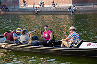 Milan,Italy - june 17 2021 - concert on a Gondola boat at sunset for charity reasons. fighting against cancer association.