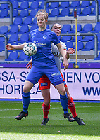 forward Hanne Merkelbach (25) of KRC Genk battles for the ball with Romy Camps (3) of Zulte-Waregem during a female soccer game between  Racing Genk Ladies and SV Zulte-Waregem on the 18 th and last matchday before the play offs of the 2020 - 2021 season of Belgian Scooore Womens Super League , saturday 27 th of March 2021  in Genk , Belgium . PHOTO SPORTPIX.BE | SPP | JILL DELSAUX