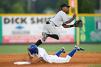 Alonzo Harris #16 of the Kingsport Mets leaps to try and catch a throw as Yowill Espinal #7 of the Burlington Royals steals second base at Burlington Athletic Park July 3, 2009 in Burlington, North Carolina. (Photo by Brian Westerholt / Four Seam Images)