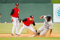 Joe De Pinto #5 of the Kannapolis Intimidators can't handle the throw as Brandon Meredith #23 steals second base at CMC-Northeast Stadium on May 20, 2012 in Kannapolis, North Carolina.  The Legends defeated the Intimidators 7-1.  (Brian Westerholt/Four Seam Images)