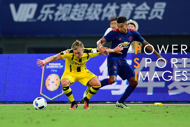 Borussia Dortmund midfielder Felix Passlack (l) fights for the ball with Manchester United midfielder Jesse Lingard (r) during the International Champions Cup China 2016, match between Manchester United vs Borussia  Dortmund on 22 July 2016 held at the Shanghai Stadium in Shanghai, China. Photo by Marcio Machado / Power Sport Images