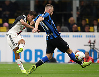 Calcio, Serie A: Inter Milano - Juventus, Giuseppe Meazza stadium, October 6 2019.<br /> Juventus' Paulo Dybala (r) scores contrasted by Inter's Milan Skriniar (l) during the Italian Serie A football match between Inter and Juventus at Giuseppe Meazza (San Siro) stadium, October 6, 2019.<br /> UPDATE IMAGES PRESS/Isabella Bonotto