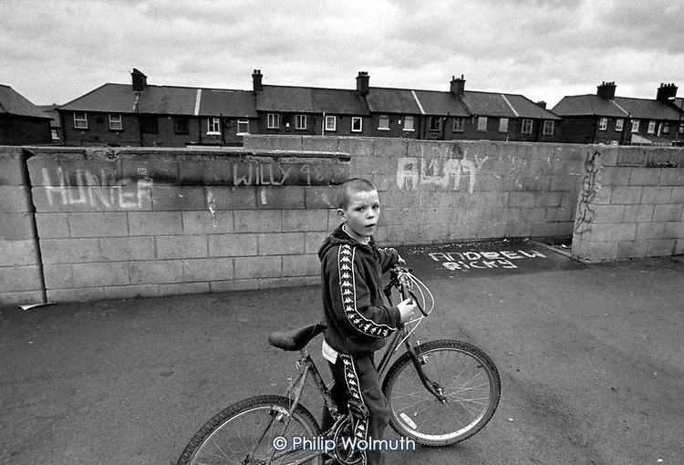 A ten-year old truant plays on his bike in Grimethorpe, South Yorkshire. The former pit village is suffering severe economic decline following closure of it's colliery and coking works.