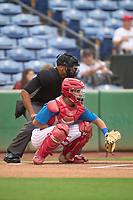 Umpire Jon-Tyler Shaw and Clearwater Threshers catcher Arturo De Freitas (12) during a game against the Fort Myers Mighty Mussels on July 29, 2021 at BayCare Ballpark in Clearwater, Florida.  (Mike Janes/Four Seam Images)