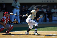Nick DiPonzio (7) of the Wake Forest Demon Deacons follows through on his swing against the Gardner-Webb Runnin' Bulldogs at David F. Couch Ballpark on February 18, 2018 in  Winston-Salem, North Carolina. The Demon Deacons defeated the Runnin' Bulldogs 8-4 in game one of a double-header.  (Brian Westerholt/Four Seam Images)