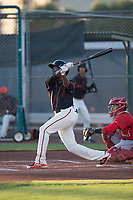 AZL Giants Black center fielder Alexander Canario (14) follows through on his swing during an Arizona League game against the AZL Angels at the San Francisco Giants Training Complex on July 1, 2018 in Scottsdale, Arizona. The AZL Giants Black defeated the AZL Angels by a score of 4-2. (Zachary Lucy/Four Seam Images)
