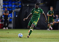 LAKE BUENA VISTA, FL - JULY 18: Larrys Mabiala #33 of the Portland Timbers passes the ball during a game between Houston Dynamo and Portland Timbers at ESPN Wide World of Sports on July 18, 2020 in Lake Buena Vista, Florida.