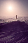 Alaska, Prudhoe Bay, North Slope, Beaufort Sea, USA, A wildlife researcher walks into blowing snow on sea ice offshore of the oilfied complex, Arctic spring,