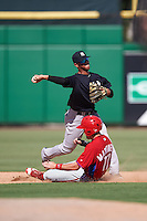 New York Yankees shortstop Wilkerman Garcia (15) throws to first as David Martinelli (17) slides into second base during an Instructional League game against the Philadelphia Phillies on September 27, 2016 at Bright House Field in Clearwater, Florida.  (Mike Janes/Four Seam Images)