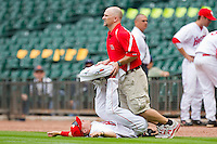 Houston Cougars trainer Max Mahaffey helps a player stretch prior to the game against the Baylor Bears at Minute Maid Park on March 4, 2011 in Houston, Texas.  Photo by Brian Westerholt / Four Seam Images