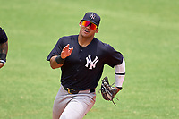 New York Yankees outfielder Jasson Dominguez (25) runs to the dugout at the end of an Extended Spring Training game against the Detroit Tigers on June 19, 2021 at the Joker Marchant Stadium in Lakeland, Florida.  (Mike Janes/Four Seam Images)