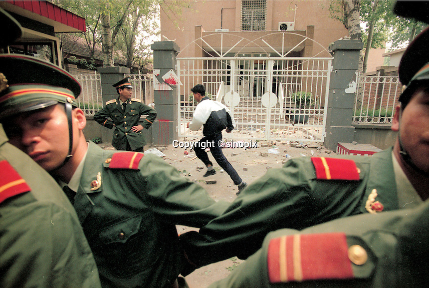 Students take turn and express their angers when passing in front of the US Embrassy. The 8 May NATO's bombarding of the Chinese Embrassy in Belgrade, caused at least four Chinese died, sparks big protest against The US & NATO, even seen for ten years in China..09-MAY-99