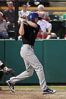 Stockton Ports third baseman Jason Christian #10 bats against the Visalia Rawhide at Recreation Park on July 30, 2011 in Visalia,California. Visalia defeated Stockton 11-2.(Larry Goren/Four Seam Images)