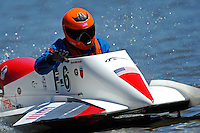 David Mitchell pats his boat after winning his class. (hydro)