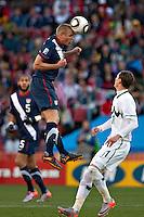 Jay DeMerit of USA heads the ball clear against Slovenia