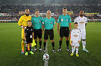 Pictured: Tim Howard of Everton with Ashley Williams of Swansea pose with match officials and children mascots before kick off. Tuesday 23 September 2014<br /> Re: Capital One Cup, Swansea City FC v Everton at the Liberty Stadium, south Wales, UK