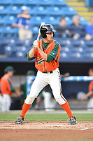 Greensboro Grasshoppers right fielder Walker Olis (7) awaits a pitch during a game against the Asheville Tourists at McCormick Field on April 27, 2017 in Asheville, North Carolina. The Tourists defeated the Grasshoppers 8-5. (Tony Farlow/Four Seam Images)