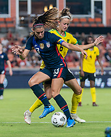 HOUSTON, TX - JUNE 13: Alex Morgan #13 of the USWNT is defended by Havana Solaun #6 of Jamaica during a game between Jamaica and USWNT at BBVA Stadium on June 13, 2021 in Houston, Texas.