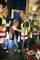 Switzerland. Canton Neuchâtel. Neuchâtel. Grape Harvest Festival. Medical care. Two men, firemen and ambulance men, both working for the SIS ( Service Incendie Secours) Neuchâtel, give the first aid to a young man who is in a ethylic coma due to an abuse of alcohol. They hold the unconscious boy in their arms, carry him and rush him to the hospital. Night life. © 2006 Didier Ruef