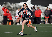 Shannon Cudahy (32) of Richmond brings the ball upfield at the practice turf field in College Park, Maryland.  Maryland defeated Richmond, 17-7.