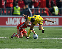 02 May 2009: Columbus Crew defender Jed Zayner #24 gets tripped up with Toronto FC forward Chad Barrett #19 at BMO Field in a game between the Columbus Crew and Toronto FC. .The game ended in a 1-1 draw.