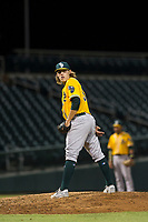 AZL Athletics relief pitcher Heath Donica (54) checks the runner at first base during a game against the AZL Cubs on August 9, 2017 at Sloan Park in Mesa, Arizona. AZL Athletics defeated the AZL Cubs 7-2. (Zachary Lucy/Four Seam Images)