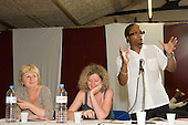 Karen Buck MP and Julie Bundy (Harrow Road Partnership) listen as author Brian Richardson addresses a 'Tell It Like It Is' meeting at the Yaa Asantewaa Centre in North Paddington: part of a national campaign questioning the under-achievement of black children in schools.