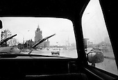 "Moscow, Russia<br /> October 19, 1992<br /> <br /> Moscow taxi drive - note very little traffic.<br /> <br /> In December 1991, food shortages in central Russia had prompted food rationing in the Moscow area for the first time since World War II. Amid steady collapse, Soviet President Gorbachev and his government continued to oppose rapid market reforms like Yavlinsky's ""500 Days"" program. To break Gorbachev's opposition, Yeltsin decided to disband the USSR in accordance with the Treaty of the Union of 1922 and thereby remove Gorbachev and the Soviet government from power. The step was also enthusiastically supported by the governments of Ukraine and Belarus, which were parties of the Treaty of 1922 along with Russia.<br /> <br /> On December 21, 1991, representatives of all member republics except Georgia signed the Alma-Ata Protocol, in which they confirmed the dissolution of the Union. That same day, all former-Soviet republics agreed to join the CIS, with the exception of the three Baltic States."