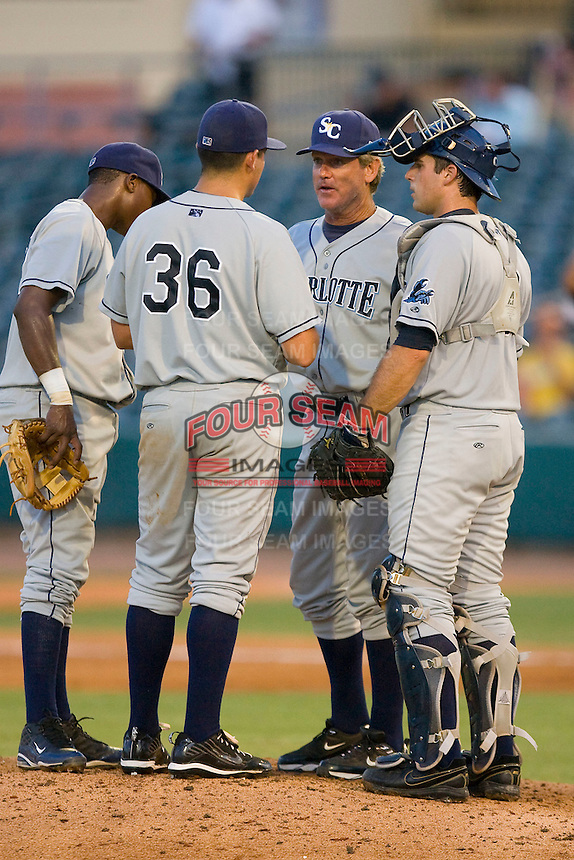 Charlotte Stone Crabs pitching coach Neil Allen #34 chats with pitcher Matthew Moore #36 as Jake Jefferies #8 and Tim Beckham #22 listen in during a Florida State League game against the Jupiter Hammerheads at Roger Dean Stadium June 15, 2010, in Jupiter, Florida.  Photo by Brian Westerholt /  Seam Images