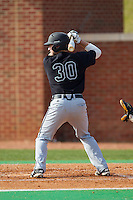 John McNulty (30) of the Coastal Carolina Chanticleers at bat against the High Point Panthers at Willard Stadium on March 15, 2014 in High Point, North Carolina.  The Chanticleers defeated the Panthers 1-0 in the first game of a double-header.  (Brian Westerholt/Four Seam Images)