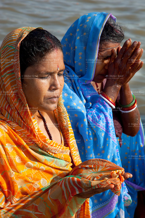 India. Uttar Pradesh state. Allahabad. Maha Kumbh Mela. Two woman pray after a holy dip in Sangam. In the Hinduism, the tilaka, tika or tilakam or tilak is a mark created by the smearing of powder or paste and worn on the forehead. Tilaka may be worn on a daily basis or for special religious occasions. The Kumbh Mela, believed to be the largest religious gathering is held every 12 years on the banks of the 'Sangam'- the confluence of the holy rivers Ganga, Yamuna and the mythical Saraswati. The Maha (great) Kumbh Mela, which comes after 12 Purna Kumbh Mela, or 144 years, is always held at Allahabad. Uttar Pradesh (abbreviated U.P.) is a state located in northern India. 7.02.13 © 2013 Didier Ruef