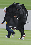 3 October 2008: Pat Perez tries to shield himself from a sudden hail storm during the second round at the Turning Stone Golf Championship in Verona, New York.