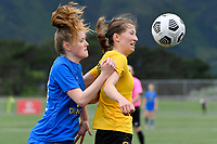 Kaley Ward of Capital competes for the ball with Erin Roxburgh of Southern during the Handa Women's Premiership - Capital Football v Southern United at Petone Memorial Park, Wellington on Saturday 7 November 2020.<br /> Copyright photo: Masanori Udagawa /  www.photosport.nz