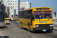 Bus and motorcycle taxi driving along the Malecon boulevard, Havana, Cuba.