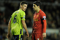 15.12.2012. Liverpool, England.  Luis Suarez  of Liverpool and  Ciaran Clark  of Aston Villa  in action during the Premier League game between Liverpool and Aston Villa from Anfield,Liverpool