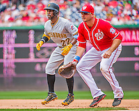 21 June 2015: Pittsburgh Pirates outfielder Andrew McCutchen takes a lead off first during a game against the Washington Nationals at Nationals Park in Washington, DC. The Nationals defeated the Pirates 9-2 to sweep their 3-game weekend series, and improve their record to 37-33. Mandatory Credit: Ed Wolfstein Photo *** RAW (NEF) Image File Available ***