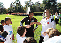 """Andy Najar and Chris Megaloudis during a  D.C United clinic in support of first lady Michelle Obama's """"Let's Move"""" initiative on the White House lawn, in Washington D.C. on October 7 2010."""