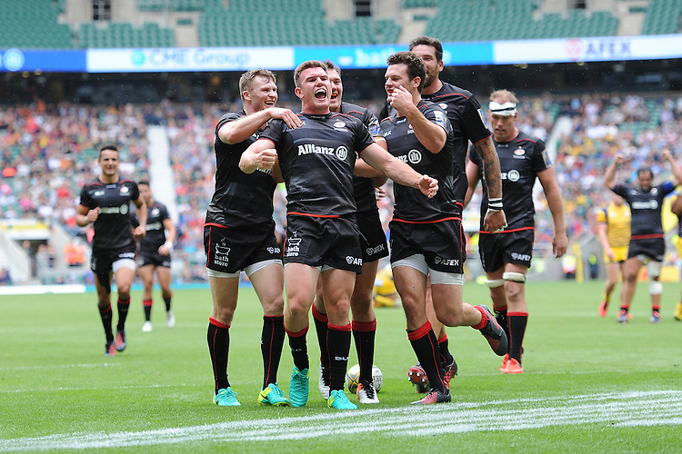 Ben Spencer of Saracens celebrates scoring a try with team mates during the Aviva Premiership Rugby match between Saracens and Worcester Warriors at Twickenham Stadium on Saturday 03 September 2016 (Photo by Rob Munro/Stewart Communications)