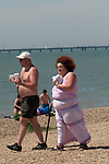 Overweight couple, obese woman using walking stick. Southend on Sea Essex 2000s. 2006 UK