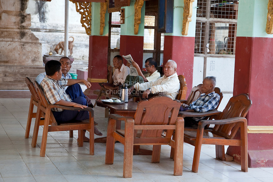 Myanmar, Burma, Bagan.  Burmese Men Talking over a Cup of Tea.