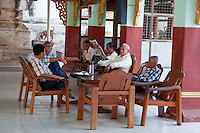 Myanmar, Burma, Bagan.  Burmese Men Talking over a Cup of Tea.