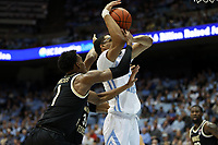 CHAPEL HILL, NC - MARCH 03: Garrison Brooks #15 of the University of North Carolina is fouled by Isaiah Mucius #1 of Wake Forest University during a game between Wake Forest and North Carolina at Dean E. Smith Center on March 03, 2020 in Chapel Hill, North Carolina.