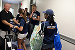 "August 20, 2011. Chapel Hill, NC.. Kimmy Summers, right, delivers bags of clothes to Randy Parrish, of Wilmington, NC, as he sets up his son's new dorm room. Summers is one of three American Eagle ""brand ambassadors"" on the UNC campus who, together with many volunteers, fanned out across the campus on move in day to help raise awareness of the brand by handing out coupons and helping incoming students move into their dorms. . Many companies have increased their efforts to reach the youth market by employing popular college students to raise the awareness of the brand by peer to peer marketing on campus' around the country."