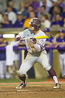 Texas A&M Aggies outfielder Nick Banks (4) squares to bunt during a Southeastern Conference baseball game against the LSU Tigers on April 24, 2015 at Alex Box Stadium in Baton Rouge, Louisiana. LSU defeated Texas A&M 9-6. (Andrew Woolley/Four Seam Images)
