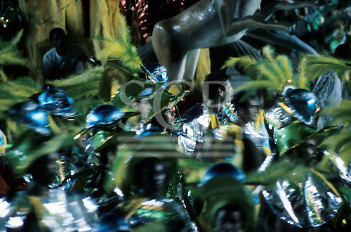 Rio de Janeiro, Brazil. Carnival samba school dancers wearing green yellow in movement.
