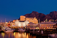 Victoria and Alfred Waterfront at dusk in Capetown, South Africa. Table Mountain serves as  a dramatic background for this beautiful city.