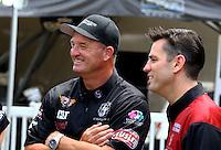 Apr 25, 2014; Baytown, TX, USA; NHRA top fuel dragster driver Bob Vandergriff Jr (left) with Larry Dixon during qualifying for the Spring Nationals at Royal Purple Raceway. Mandatory Credit: Mark J. Rebilas-